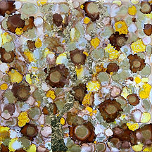 gyellow, gold and brown alcohol ink painting on tile