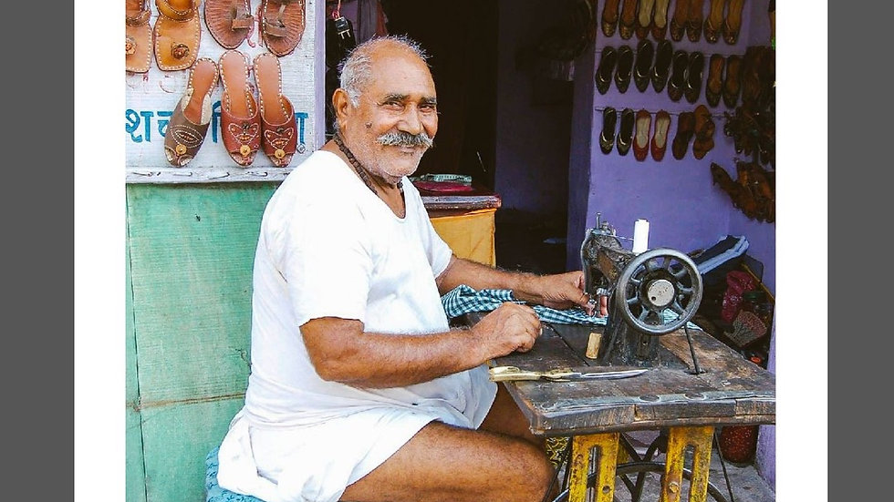 Shoe maker looking proud, Uttar Pradesh