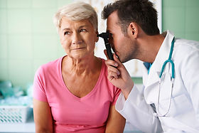 doctor-examining-ear-of-senior-woman.jpg