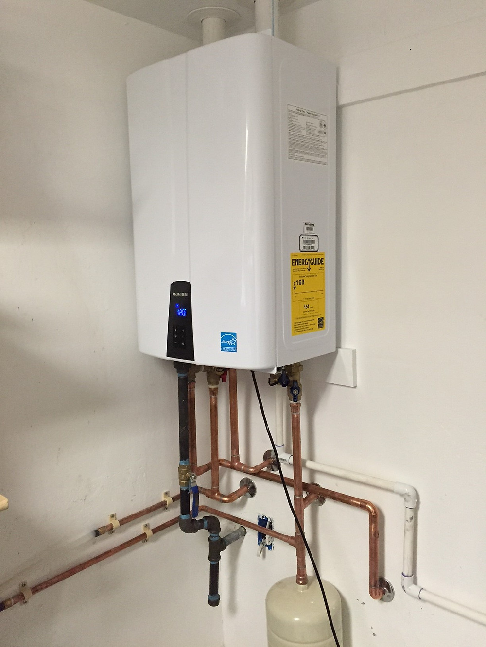 Plumber installs a Tankless Water Heater in Flagstaff
