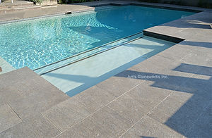 coffee limestone, brown limestone, limestone pool coping, limestone paving, brown limestone, fine adze finish, limestone water feature, limestone paving, stone water drain