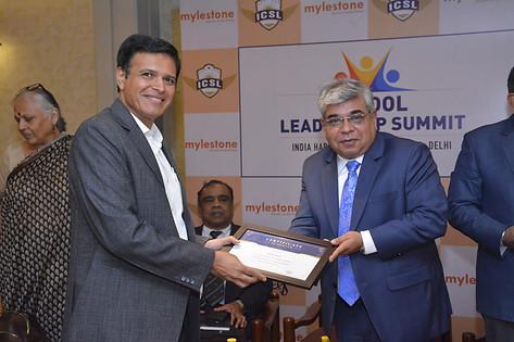 Panelist Dr. Atul Nischal receives souvenir from Mr. Vinay Sharma