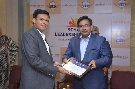 Panelist Dr. Rajesh Hassija receives souvenir from Mr. Vinay Sharma