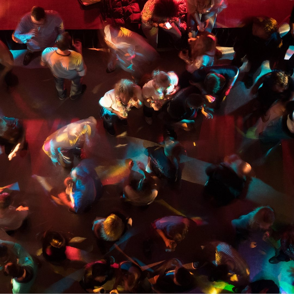 aerial view of dancers mixing in a nightclub