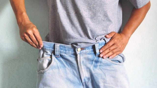 man-weight-loss-waistline-loose-jeans.jpg