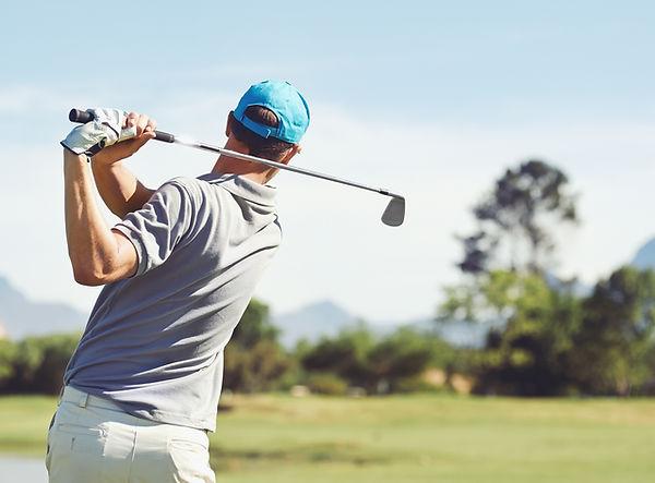 Golfer hitting golf