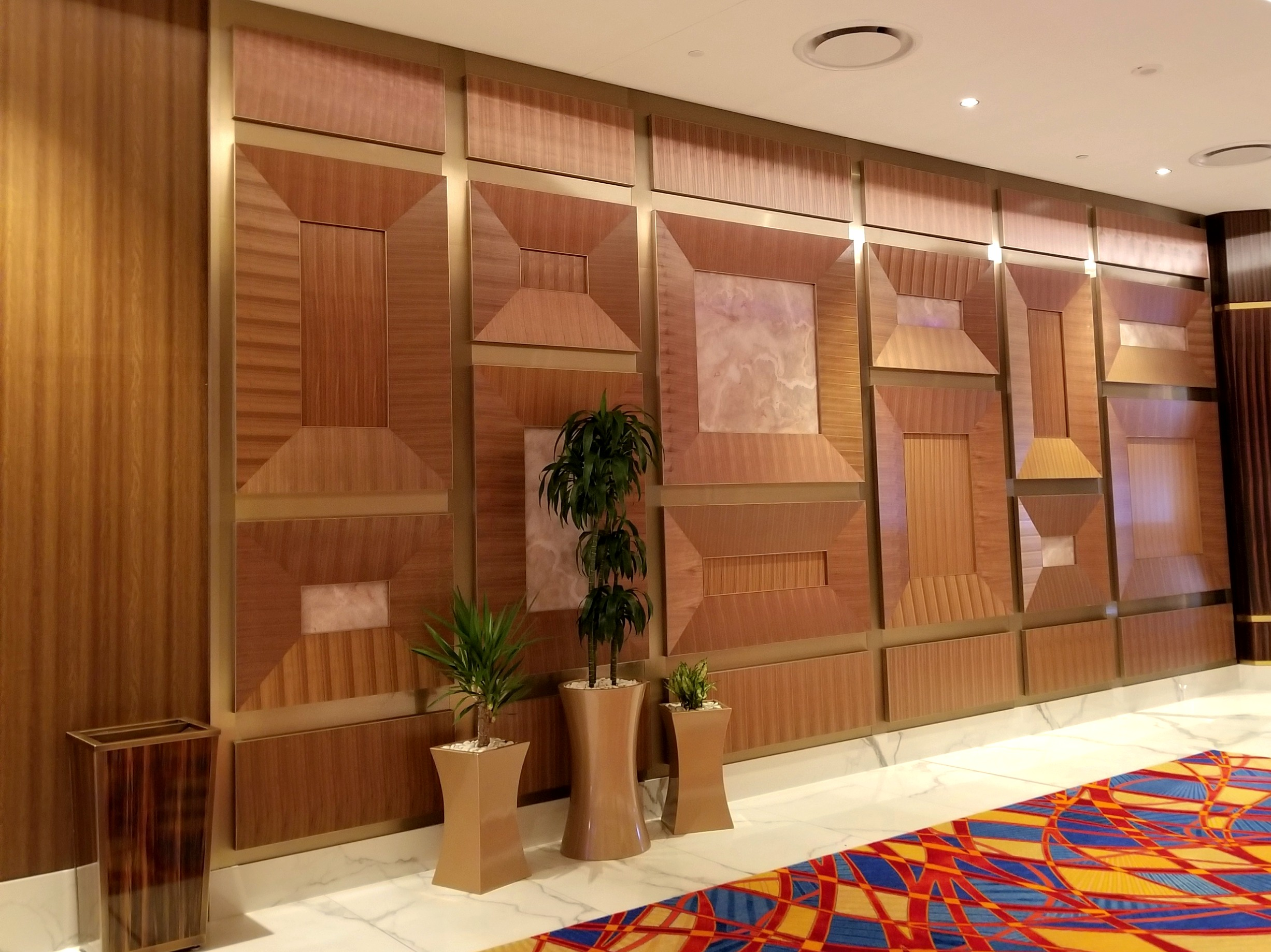 Designed and manufactured walnut veneer wall