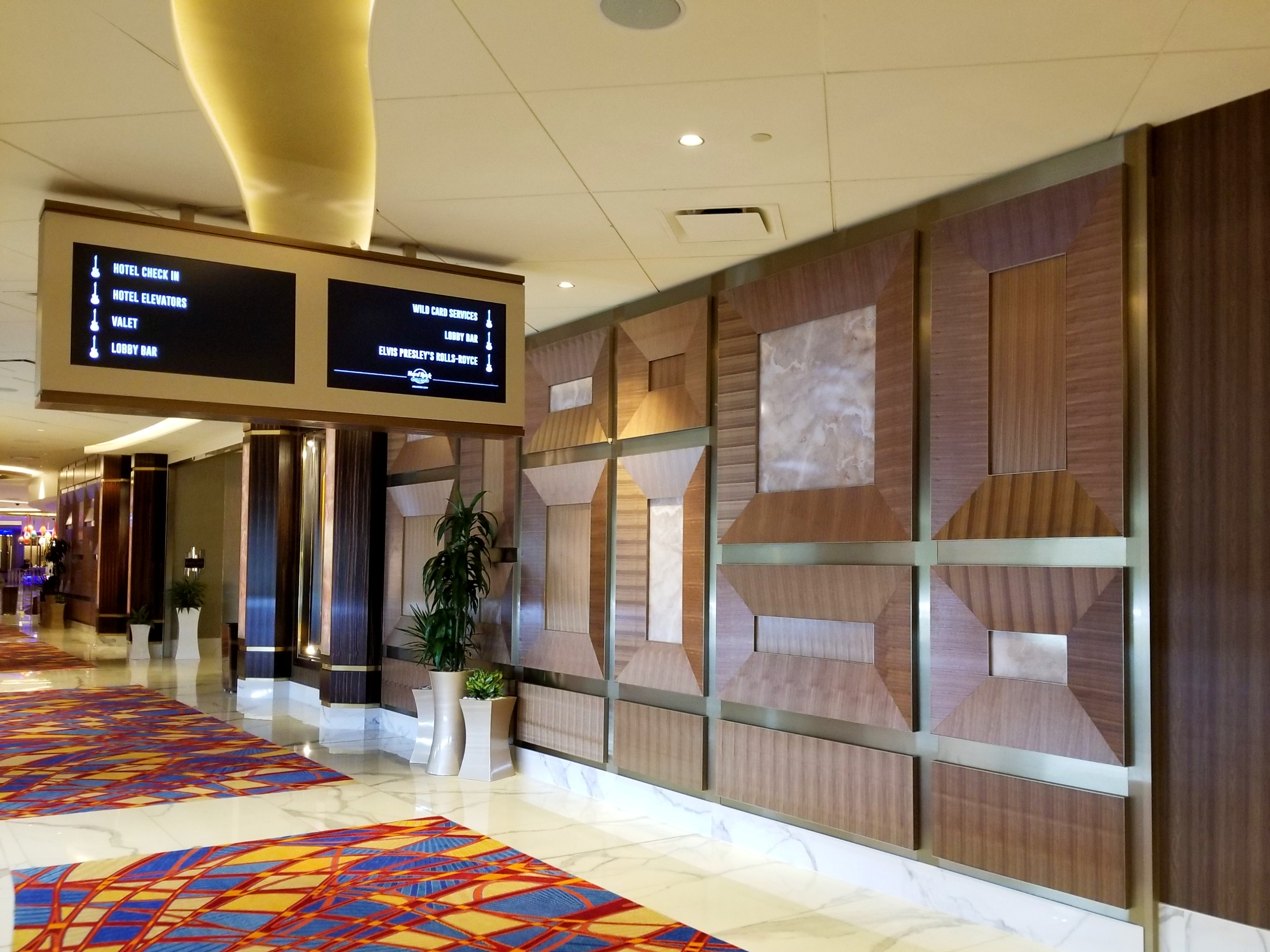 Walnut Veneer Wall and Digital Directional Sign