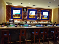 Bar Millwork, LCD Surrounds, Glass Shelving and Padded Wall