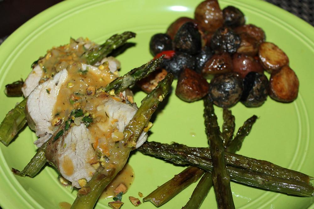 Pork Tenderloin with Roasted Asparagus and Warm Citrus Sauce Plate.JPG