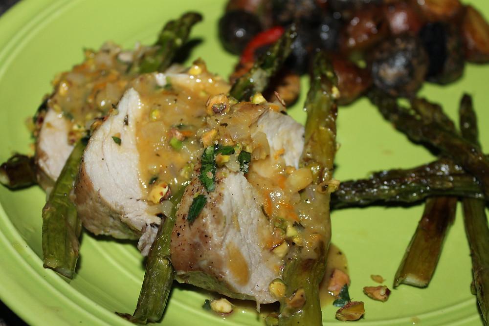 Pork Tenderloin with Roasted Asparagus and Warm Citrus Sauce Close-Up.JPG