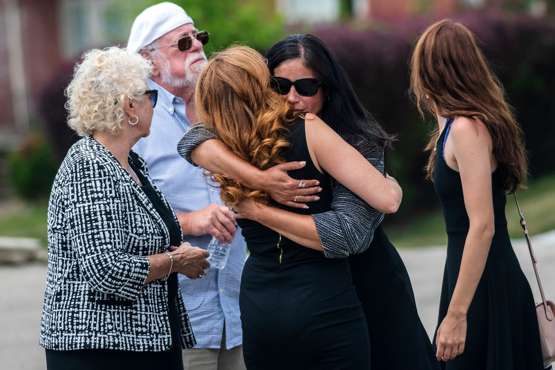 The family of Nicholas Cumer, the Pittsburgh-area man who was killed in the August 4 mass shooting in Dayton, Ohio, embrace after the conclusion of his funeral service Saturday, August 10, 2019, at Piatt and Barnhill Funeral Directors Inc in Washington. Nicholas Cumer graduated from Washington High School in 2012 and was a graduate student at St. Francis University in the school's Master of Cancer Care program. He was in Dayton as part of his internship with the Maple Tree Cancer Alliance, where he had just been offered a full-time position.