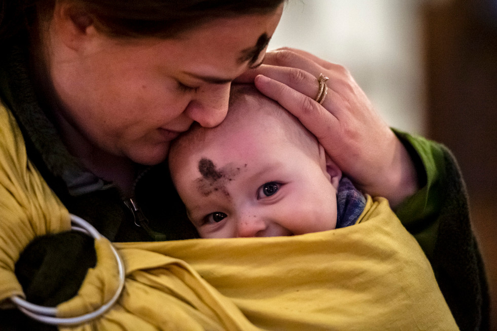 Lindsay Beel of Regent Square embraces her son Elliot as he smiles during Ashes for Little Kids a special Ash Wednesday service, Wednesday, March 6, 2019, at St. Stephen's Church in Wilkinsburg. Ash Wednesday is a holy day of prayer, fasting and repentance and marks the first day of Lent.