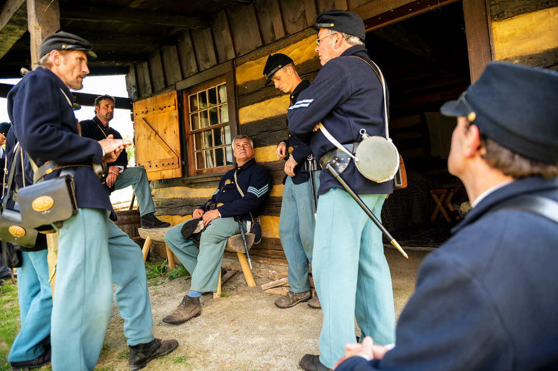 Civil War Union reenactment soldiers take a break while preparing for a reenactment battle at the Westmoreland Historical Society's Civil War encampment and battle reenactment, Saturday, July 27, 2019 at Historic Hanna's Town in Greensburg. The reenactment had various activities that included a battle reenactment, military drills, and artillery demonstrations.