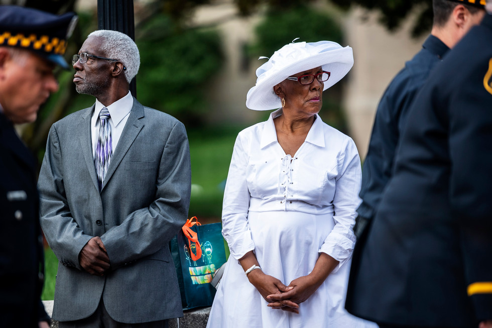 George E. Green Jr, left, and his wife Shirley Green, both of Brentwood, right, watch as Pittsburgh police officers line up to enter the funeral of Pittsburgh police Officer Calvin Hall, Tuesday July 23, 2019, at Soldiers & Sailors Memorial Hall and Museum in Oakland. Officer Hall, 36, was off duty when he was fatally shot in the early morning hours of July 14 in Homewood and succumbed to his wounds on July 17.