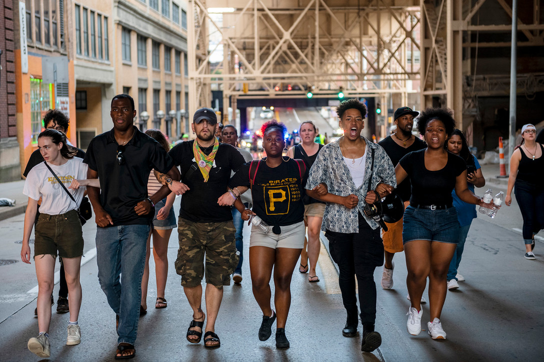 Demonstrators march with interlocking arms down Second Avenue demanding justice for Dontay Green on Wednesday July 25, 2018, in Downtown. The group of about 30 protestors were demanding justice and accountability for Dontay Green who was shot in the leg by a Zone 3 police officer on July 15.