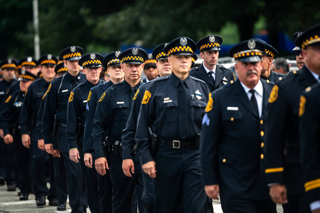 Pittsburgh police officer march on Fifth Avenue en-route to the funeral of Pittsburgh police Officer Calvin Hall, Tuesday July 23, 2019, at Soldiers & Sailors Memorial Hall and Museum in Oakland. Officer Hall, 36, was off duty when he was fatally shot in the early morning hours of July 14 in Homewood and succumbed to his wounds on July 17.