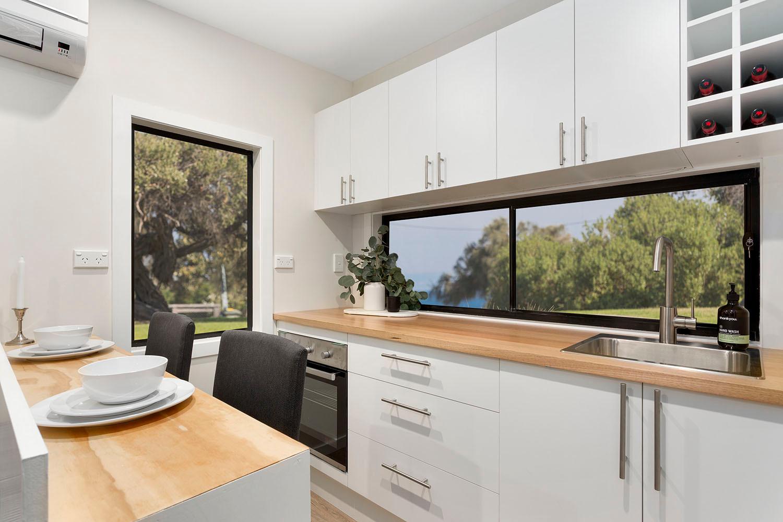 white kitchen full sized amenities
