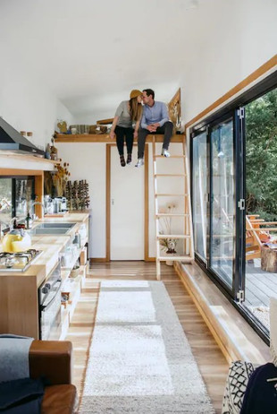 couple living in tiny home happy