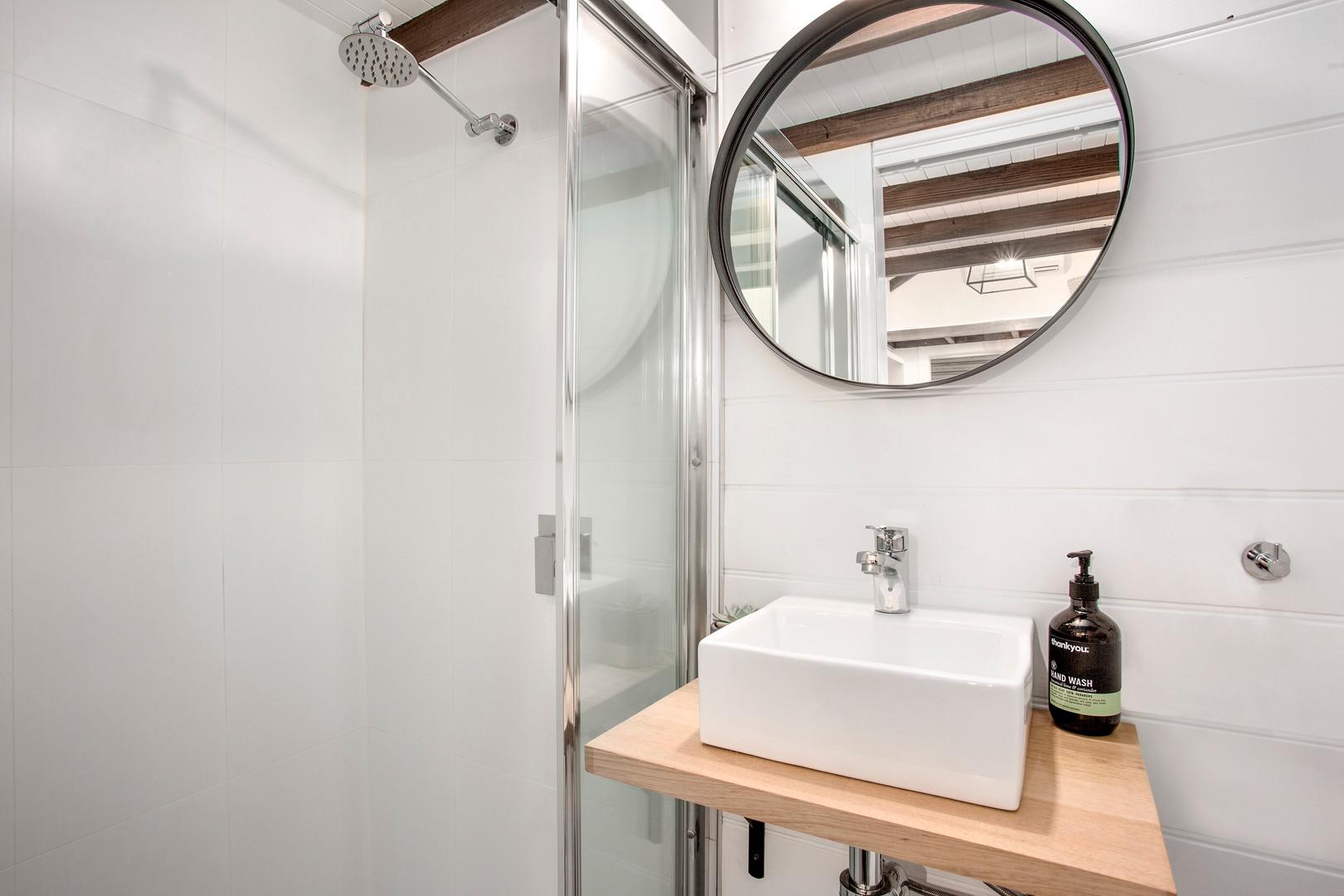 bathroom full mirror and sink