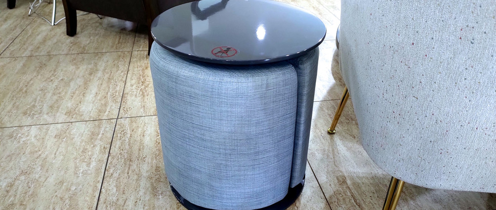 Round Accent Table with Pull-Out Ottoman