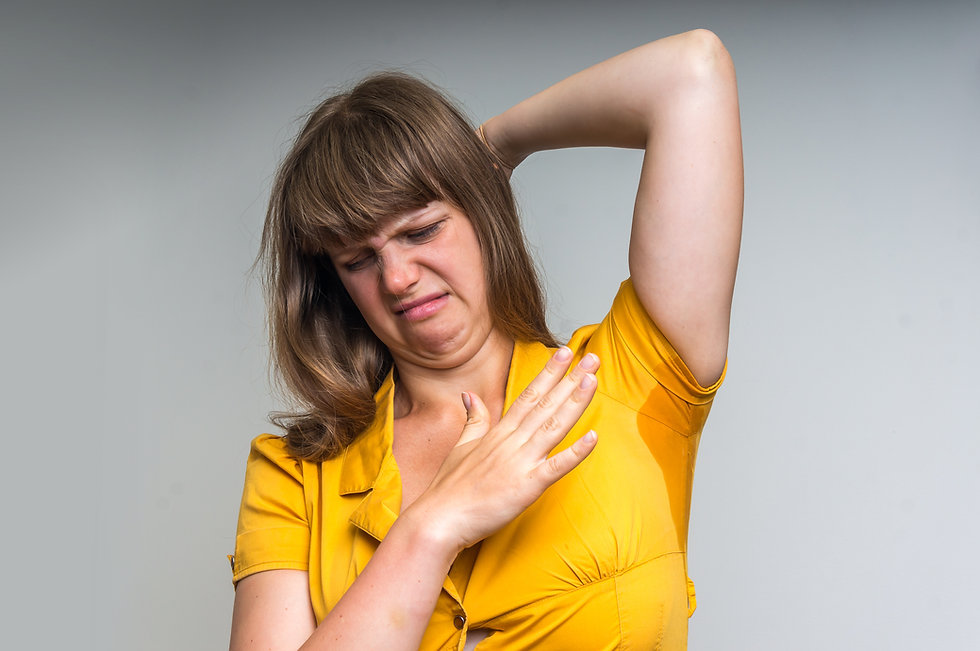 Woman With Sweating Under Armpit In Yell