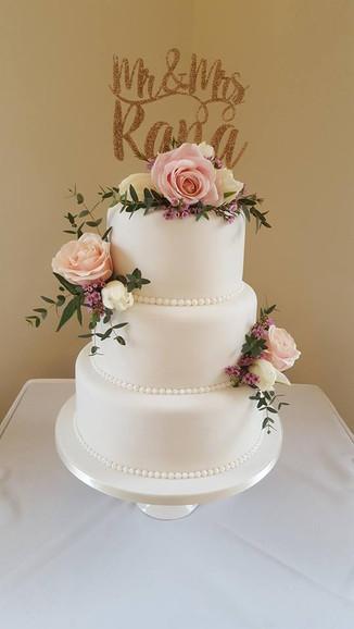 Three tier iced Wedding Cake