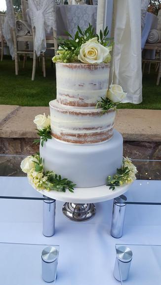 Semi-Naked with iced bottom tier Wedding Cake