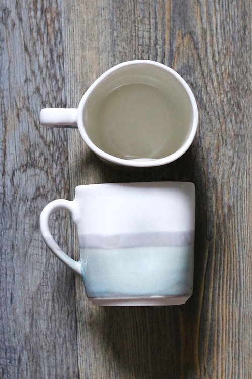 Grey skies squashed mug