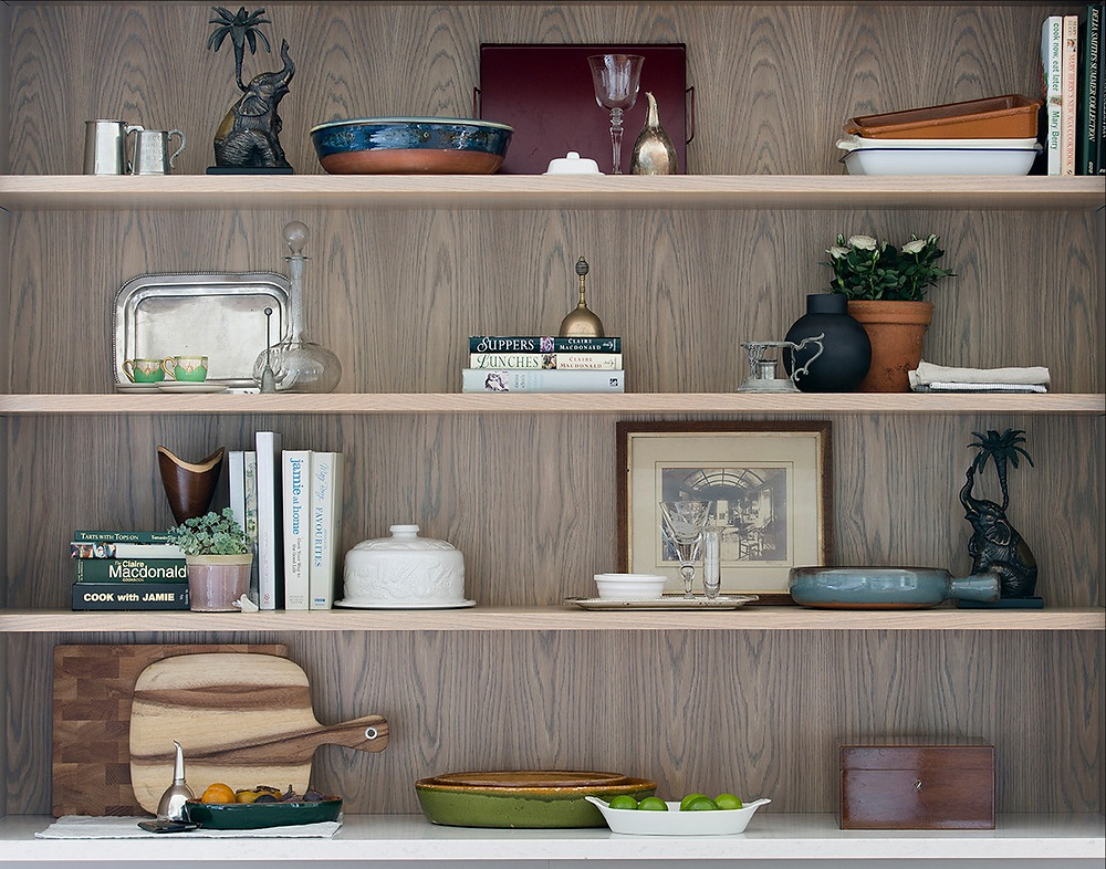 Eclectically dressed kitchen shelves