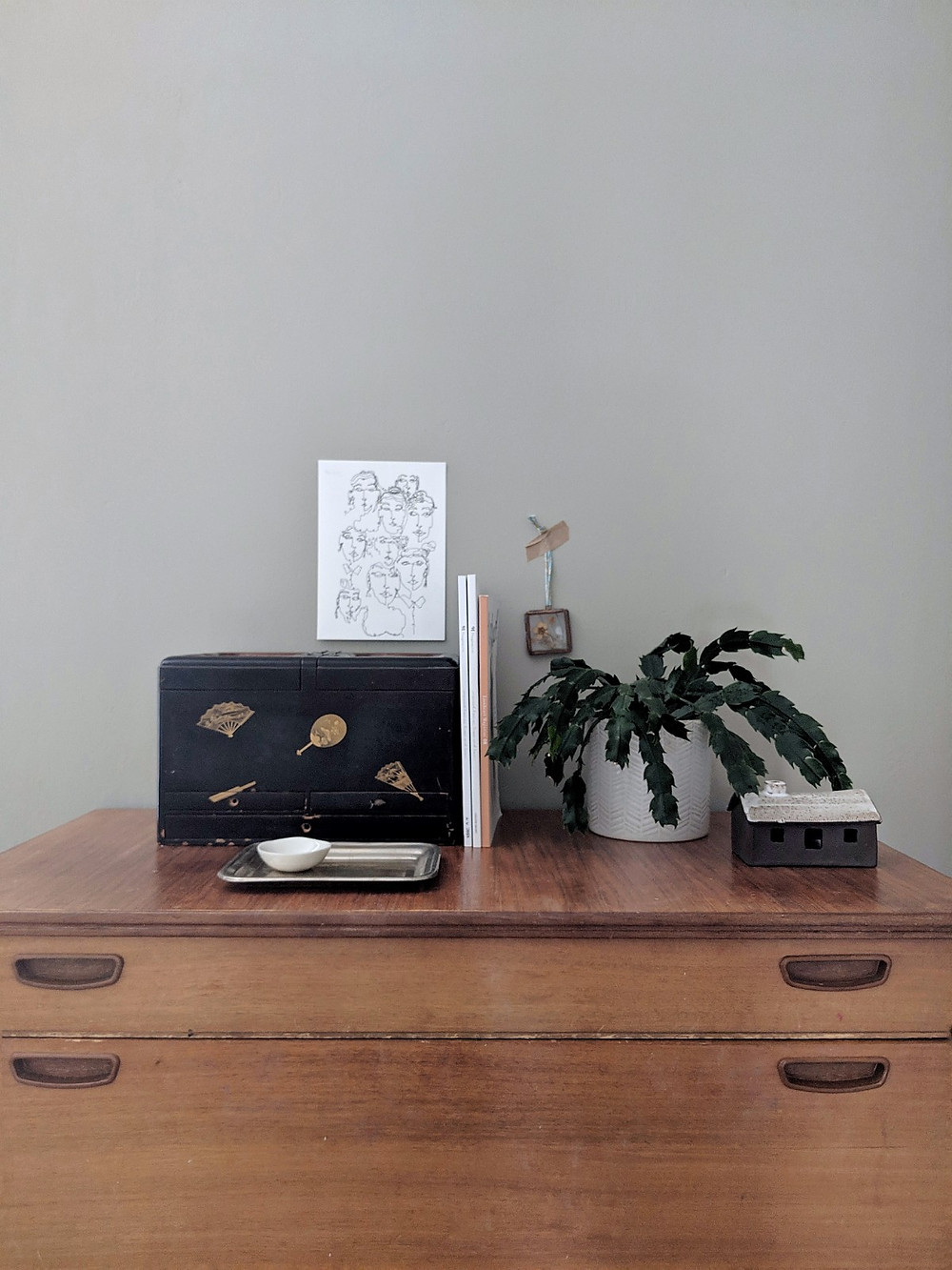 top of chest of drawers styling. Black box, plants, Katie Barclay print, Foxed ceramic bothy.