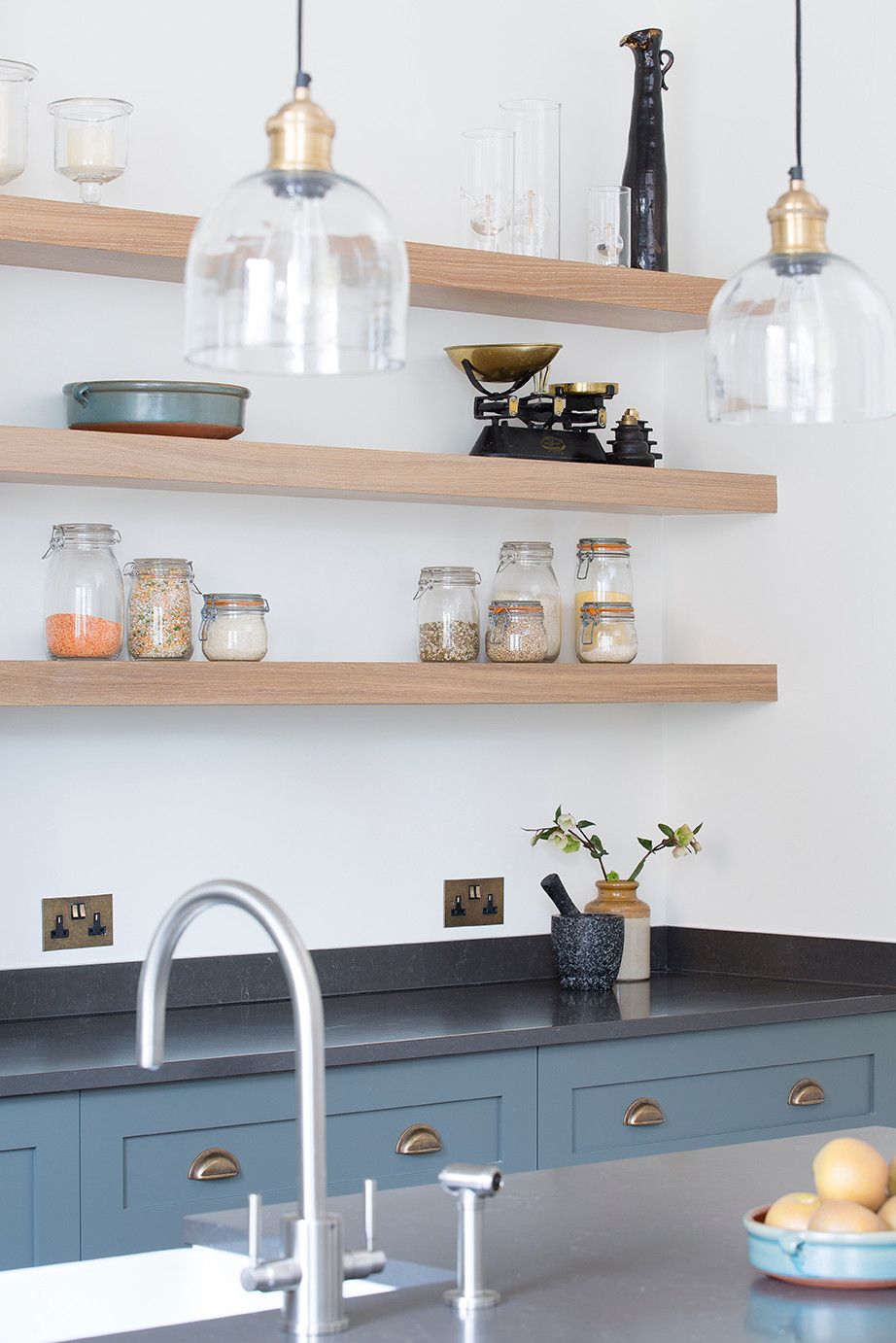 Blue kitchen units and open shelving