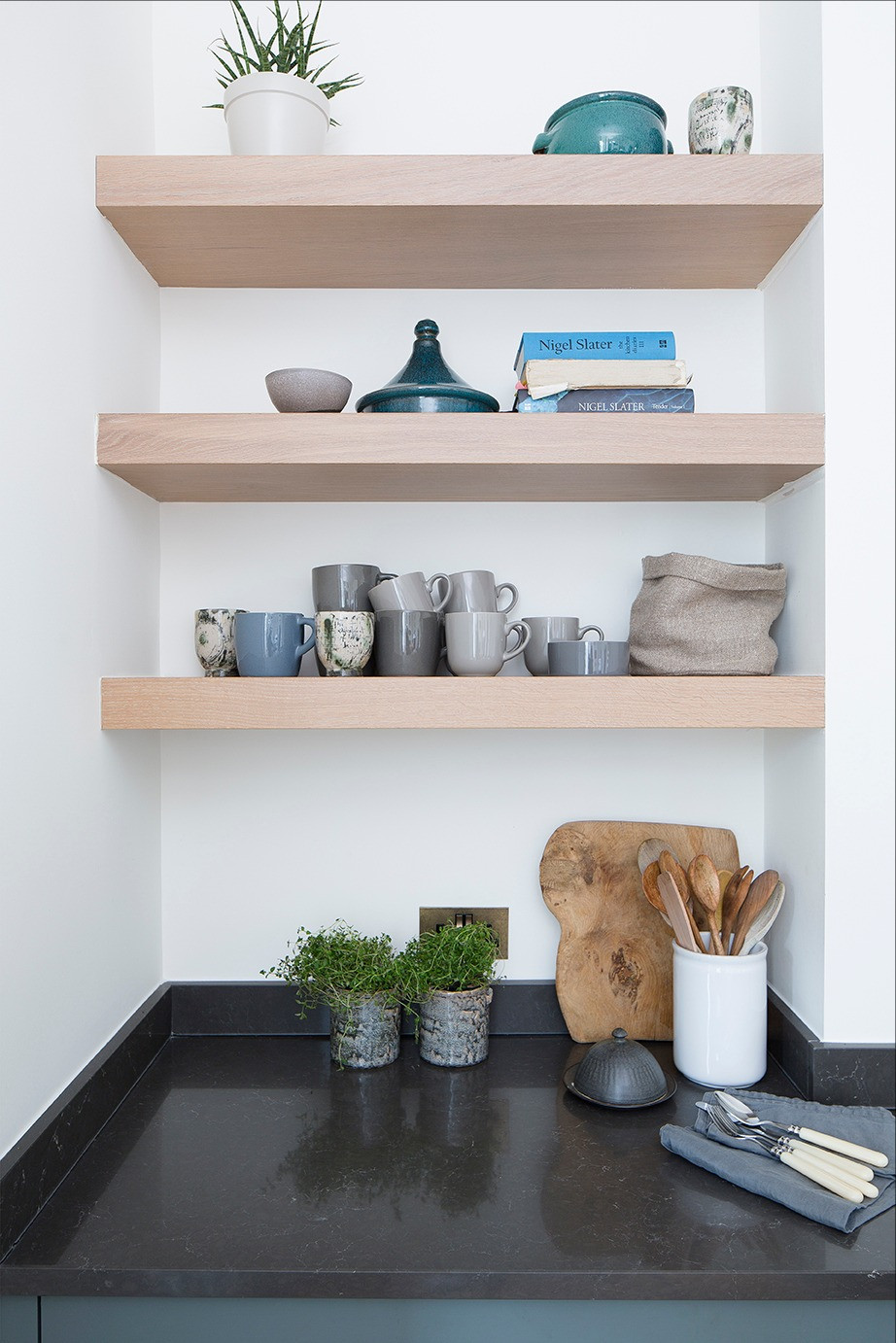 Blue and grey tableware on wooden shelves