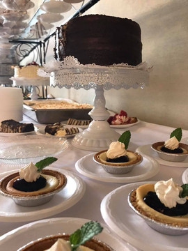 An assortment of cake and mini pies.