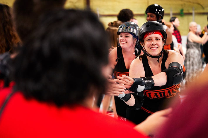 Tallahasssee Roller Derby Players High Five Crowd