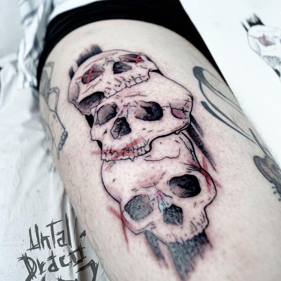 Tatuaje de calaveras en InkCubo