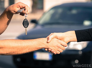 person-holding-keys-and-shaking-hands-wi