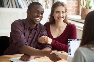 Smiling multiracial couple customers sha