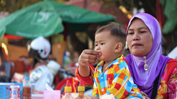 Une maman musulmane et son fils
