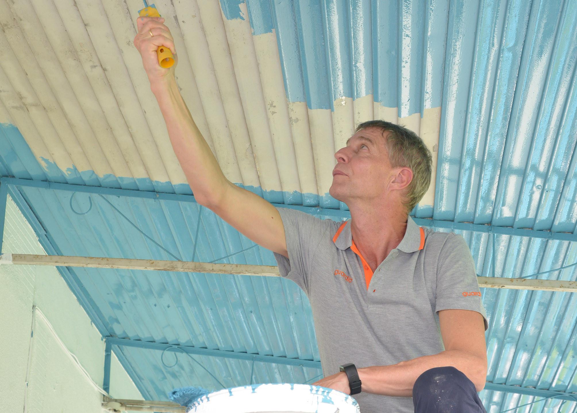Leading by example, CEO Guardian Malaysia Mr Soren Lauridsen helping to repaint the roof of Pertubuhan   Kebajikan Anak Yatim Mary