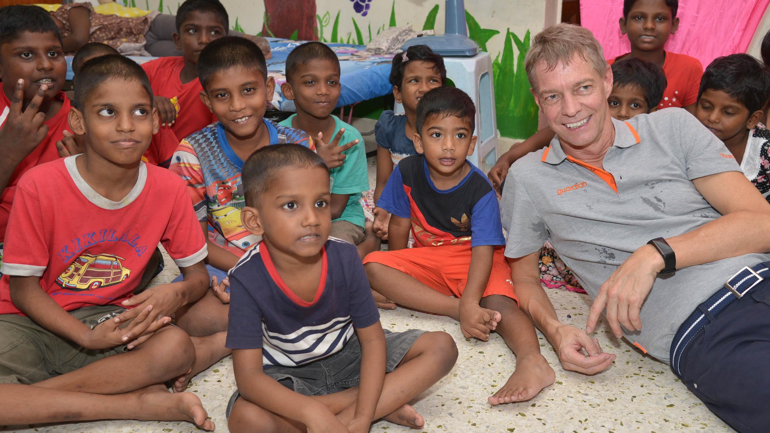 Mr Soren Lauridsen, CEO of Guardian Malaysia posing with residents of Pertubuhan   Kebajikan Anak Yatim Mary