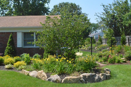 Front yard planting and rock wall.jpg