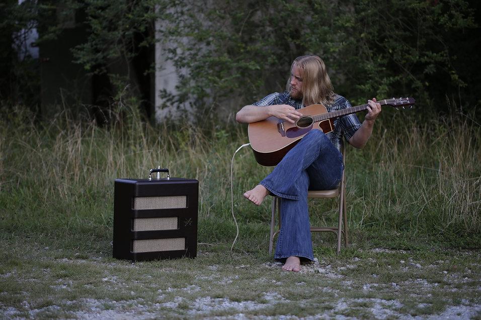 BJ Wilbanks playing acoustic guitar