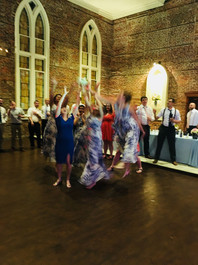 Bridesmaids and friends fight for the bouquet