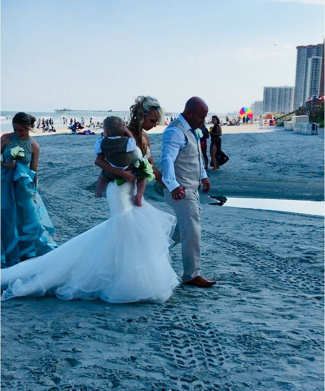 Bride and Groom walking off after beach wedding ceremony