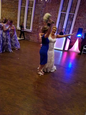 Bride and Bridesmaid celebrate the catch