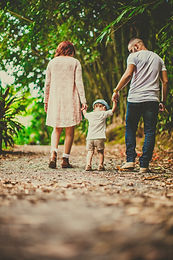 low-angle-shot-of-a-child-held-by-woman-