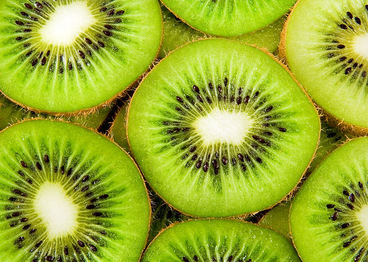 beautiful kiwi fruit slices background.j