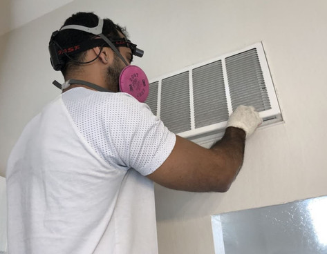 man-doing-air-duct-cleaning-wearing-mask