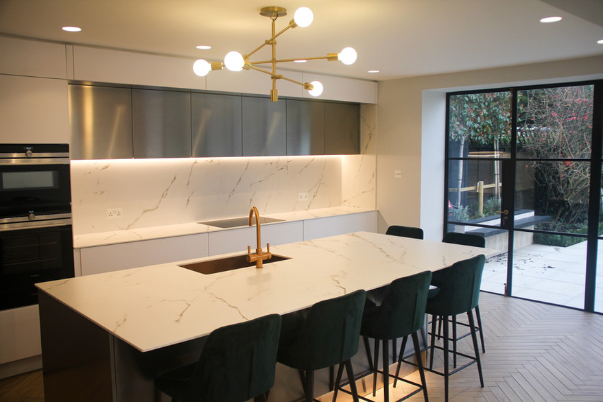 White kitchen units, paired with Stainless steel island and Dekton worktop and slashback
